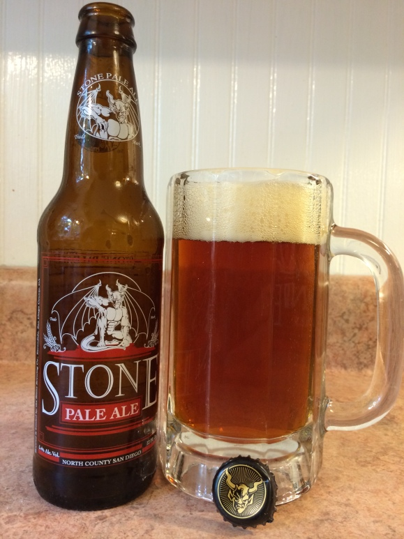 Stone Pale Ale in a glass stein, with my formica countertop and wainscoting kitchen wall.